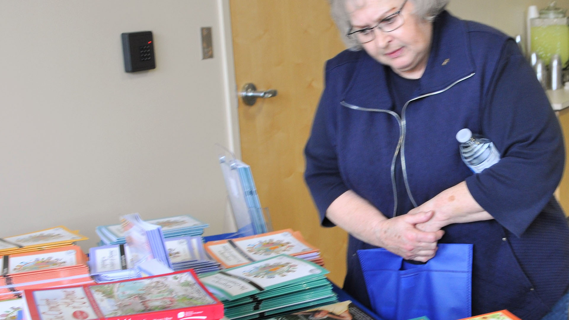caregiver with books